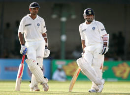 Indian batsmen Rahul Dravid, left, and Sachin Tendulkar wait for the third umpire's decision during the third days play of the tfinal test cricket match in Colombo, Sri Lanka, Sunday, Aug. 10, 2008.