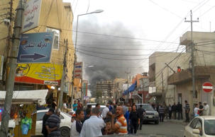 Smoke rises after an explosion near the U.S. Consulate in Erbil, Iraq, April 17, 2015.