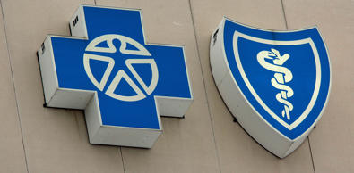 The Blue Cross Blue Shield logos. Carlos Osorio/AP