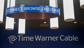Time Warner Cable Inc. signage is displayed at the company's store in New York. Michael Nagle/Bloomberg