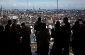 Visitors look out over the Dublin city skyline from the viewing gallery in the Guinness Gravity Bar at the company's St. James's Gate Brewery