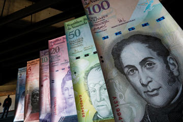 Samples of Venezuela's currencies are displayed at the Central Bank building in Caracas February 10, 2015. Venezuela on Tuesday launched a new foreign exchange platform that will likely devalue the bolivar heavily in efforts to bolster state coffers amid tumbling oil revenue, but risks a spike in already soaring inflation.