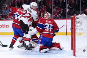 The pucks goes past Carey Price #31 of the Montreal Canadiens on a shot by Patrick Wiercioch #46 of the Ottawa Senators (not pictured) during Game Five of the Eastern Conference Quarterfinals of the 2015 NHL Stanley Cup Playoffs at the Bell Centre on April 24, 2015 in Montreal, Quebec, Canada.