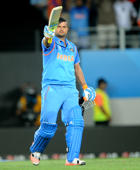 India's Suresh Raina waves his bat after scoring a century while batting against Zimbabwe during their Cricket World Cup Pool B match in Auckland, New Zealand, Saturday, March 14, 2015.