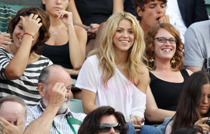 Colombian singer Shakira, centre, watches Spain's Rafael Nadal during his fourth round match against France's  Paul-Henri Mathieu All England Lawn Tennis Championships at Wimbledon,  Monday, June 28, 2010. (AP Photo/Jon Super)