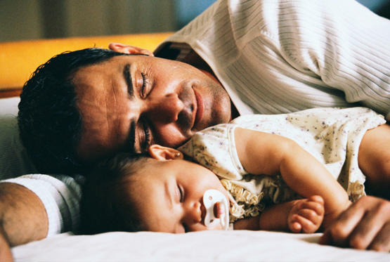 Father and Infant Daughter Sleeping