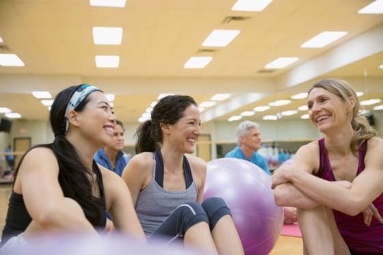 Smiling women talking in exercise class