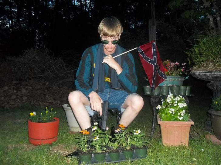 A photo from a white supremacist website showing Dylann Storm Roof, the suspect in the Charleston, S.C., church shooting.