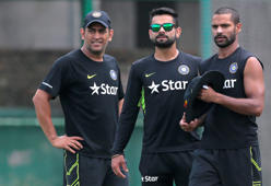 India's captain Mahendra Singh Dhoni, left, teammates Virat Kohli, center, and Shikhar Dhawan attend a practice session a day ahead of their one-day international cricket match against Bangladesh in Dhaka, Bangladesh, Wednesday, June 17, 2015.