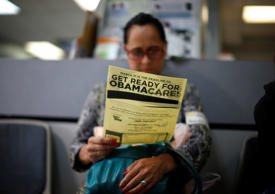 Arminda Murillo, 54, reads a leaflet at a health insurance enrollment event in C...