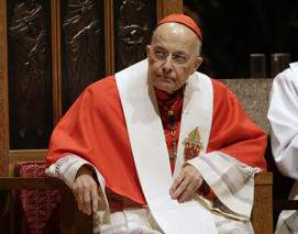 In this Nov. 17, 2014 file photo, retiring Cardinal Francis George listens at Holy Name Cathedral in Chicago during Bishop Blase Cupich's Rite of Reception service.