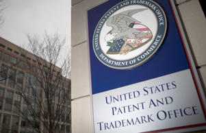 The U.S. Patent and Trademark Office seal is displayed outside the headquarters in Alexandria, Virginia, U.S., on Friday, April 4, 2014.