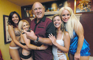 "Owner Dennis Hof poses with some of his ""working girls"" in the parlor of his Moonlite BunnyRanch in Mound House, east of Carson City, Nev."