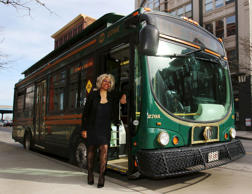 Crystal Hill, a Cleveland regional Transit Authority Trolley driver poses outside her trolley as Tina Turner as part of the Rock and Roll Hall of Fame Induction week in Cleveland, Ohio April 15, 2015.
