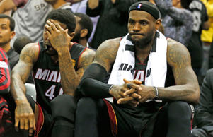 A dejected Miami Heat forward LeBron James with Miami Heat's forward Udonis Haslem on the bench in the final moments of the fourth quarter in Game 5 of the NBA Finals at the AT&T Center in San Antonio, Texas on Sunday, June 15, 2014.