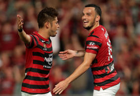 Mark Bridge of the Wanderers celebrates scoring a goal with team mate Yusuke Tanaka during the round 26 A-League match between the Western Sydney Wanderers and Adelaide United.