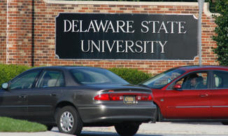Vehicles await entry at an entrance to Delaware State University in Dover, Delaware, September 21, 2007.