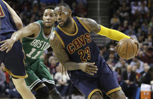 Cleveland Cavaliers' LeBron James (23) drives past Boston Celtics' Evan Turner (11) during an NBA basketball game Friday, April 10, 2015, in Cleveland.