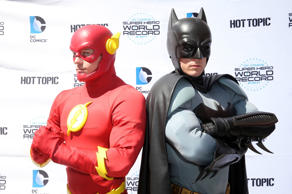 Fans pose dressed as DC Comics Super Heroes at the DC Comics Super Hero World Record Event at the Hollywood & Highland Center on April 18, 2015 in Los Angeles, California.