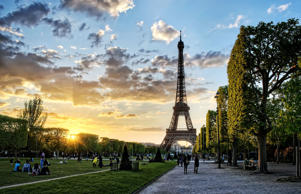 The Eiffel Tower from Champ de Mars in Paris, France during sunset.