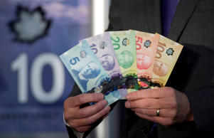 The new polymer bank notes are pictured at the central train station in Vancouver, Thursday, Nov. 7, 2013.