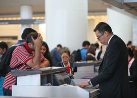 File photo of a traveler speaking to an airline ticket agent at San Francisco International Airport. Justin Sullivan/Getty Images