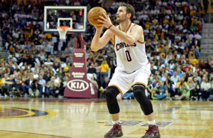 Cleveland Cavaliers forward Kevin Love shoots in the second quarter against the Washington Wizards at Quicken Loans Arena on April 15, 2015, in Cleveland.