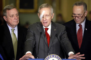 U.S. Senate Minority Leader Harry Reid (D-NV) (C) is flanked by Senator Dick Durbin (D-IL) (L) and Senator Charles Schumer (D-NY) (R) during a news conference after the weekly Senate party caucus luncheons at the U.S. Capitol in Washington February 10, 2015.