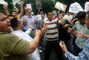 File: Kashmiri pandits, or Hindus, shout during a protest inside the residence of Indian Water Resources Minister Saifuddin Soz in New Delhi July 6, 2008.