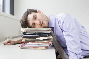An employee takes a power nap in between office hours.
