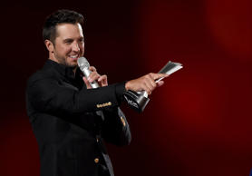 ARLINGTON, TX - APRIL 19:  Singer Luke Bryan accepts the award for Entertainer of the Year onstage during the 50th Academy Of Country Music Awards at AT&T Stadium on April 19, 2015 in Arlington, Texas.  (Photo by Ethan Miller/Getty Images for dcp)