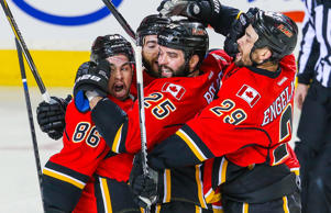Calgary Flames left wing Brandon Bollig celebrates his goal with teammates against the Vancouver Canucks during game three of their Stanley Cup playoff series April 19 in Calgary, Alberta.