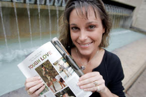 Former U.S. Air Force Staff Sgt. Michelle Manhart poses with the February 2007 issue of Playboy magazine in San Antonio, Thursday, Jan. 11, 2007.
