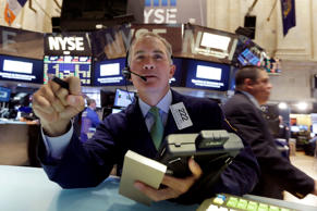 Trader Timothy Nick works on the floor of the New York Stock Exchange, Monday, April 20, 2015.