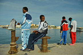 Surviving African immigrants from the boat-wreck tragedy off Lampedusa island in Lampedusa, Italy, in 2013.