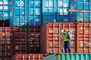 A worker stands on a shipping container at a container terminal in Tokyo, Japan, on Tuesday.