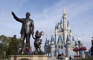 A statue of Walt Disney and Mickey Mouse stands in front of the Cindrella's castle at Walt Disney World's Magic Kingdom in Lake Buena Vista, Fla.