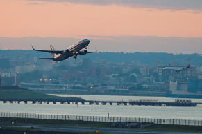 An American Airlines plane takes off from LaGuardia Airport.