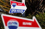 RE/MAX Holdings Inc. signage is displayed outside of an open house in Redondo Beach, California, U.S., on Saturday, Feb. 14, 2015.
