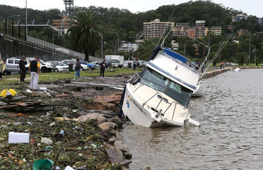 A boat is washed up on the Gosford Waterfront on the Central Coast.