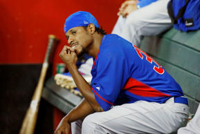 Chicago Cubs' Edwin Jackson bites his nails as he sits in the dugout in the fourth inning of a spring training baseball game against the Arizona Diamondbacks, Friday, March 28, 2014, in Phoenix.