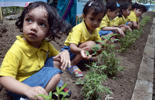 Young Indian schoolchildren participate in a tree planting programme on the occasion of Earth Day in Kolkata on April 22, 2015.  Earth Day is observed each April 22, during which events are held worldwide to demonstrate support for environmental protection.   AFP PHOTO / Dibyangshu SARKAR        (Photo credit should read DIBYANGSHU SARKAR/AFP/Getty Images)