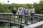 U.S. President Barack Obama takes a walking tour of the Anhinga Trail at Everglades National Park, Florida April 22, 2015. Obama is visiting the subtropical swamps of the park on Wednesday, part of a push to get Americans thinking and talking about the damage climate change is causing close to home.