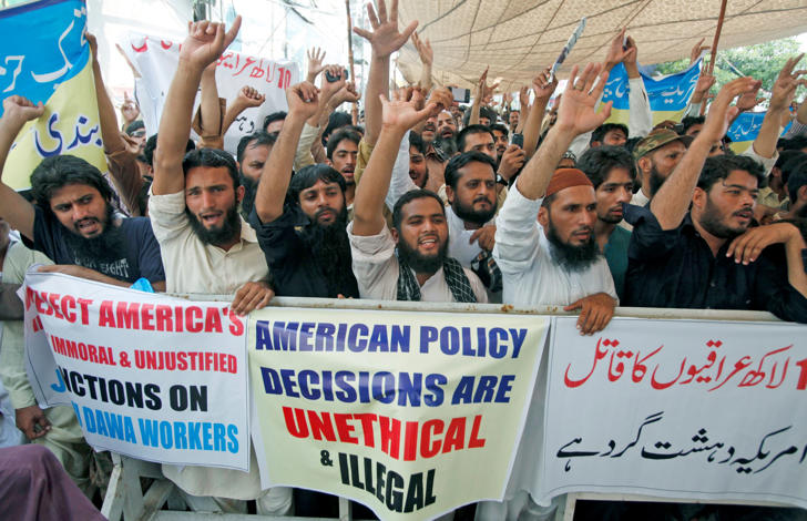 Supporters of the Jamaat-ud-Dawa organisation chant slogans during a protest in Lahore, Pakistan.