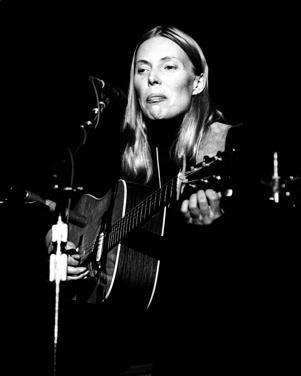Joni Mitchell performing at the 'Save the Whales Benefit' in Memorial Auditorium in Sacramento, California on November 20, 1976.