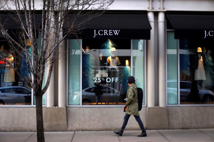 Pedestrian passing in front of a J.Crew store in Pittsburgh