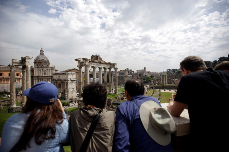 Tourists visit the ancient Roman forum in Rome, April 17, 2015.