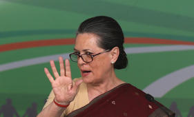 File: Chief of India's ruling Congress party Sonia Gandhi gestures as she answers a question during the release of the party's manifesto for the April/May general election in New Delhi March 26, 2014.