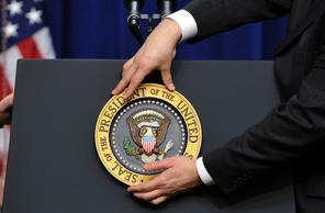 "A staff fixes the presidential seal before US President Barack Obama gives a press conference in the Eisenhower Executive Office Building at the White House in Washington, DC, on December 22, 2010. Obama celebrated the Senate ratification of a nuclear arms reduction treaty with Russia, saying it ""sends a powerful signal to the world."" AFP PHOTO/Jewel Samad (Photo credit should read JEWEL SAMAD/AFP/Getty Images)"