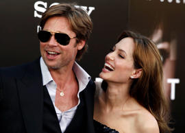 "Angelina Jolie, right and Brad Pitt arrive at the premiere of ""Salt"" in Los Angeles."